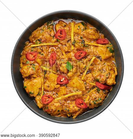Chicken Handi In Black Bowl Isolated On White Background. Murgh Chicken Is Indian Cuisine Curry Masa