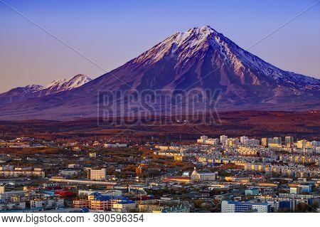 Panoramic View Of The City Petropavlovsk-kamchatsky And Volcanoes: Selective Focus. Koryaksky Volcan