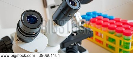Science microscope on lab bench. Microbiology laboratory. Water sampling procedure for microbiological analysis