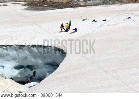 Mittelberg, Austria - June 23, 2020: Rope Team Training Crevasse Rescue On Glacier Taschachferner An
