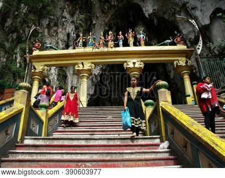 Batu Caves, Kuala Lumpur, Malaysia, January 30, 2016: People Going Down And Up The Stairs Of The Bat