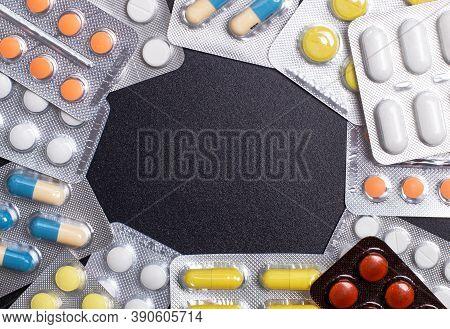Pharmaceuticals, Antibiotics, Tablets, Medications. Colorful Antibacterial Pills On A Dark Backgroun