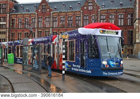 Amsterdam, Netherlands - December 6, 2017: People Ride The Gvb Electric Tram (combino Model Made By