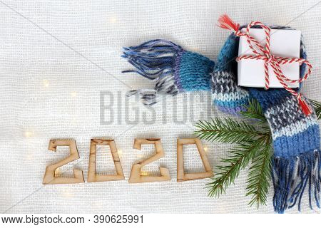 Gift, Spruce Branch And Scarf On The Background With Lights And A Number. Two Thousand And Twentieth