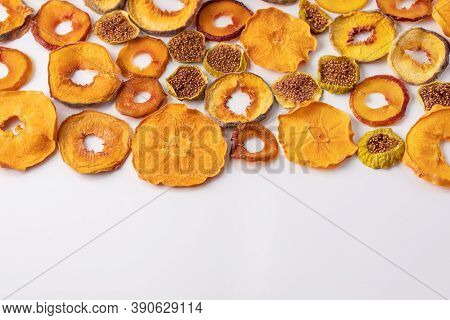 Slices Of Dried Persimmon, Peach, Plum And Figs On A White Background. Dried Fruits. Eco.