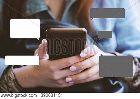 Texting On Smartphone Concept With Chat Or Speech Bubbles - Unrecognizable Young Woman Using Mobile