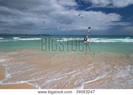 Windsurfer And Kite Surfers On The Atlantic Ocean, Canary Islands, Fuerteventura