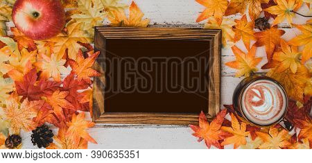 Autumn And Fall Season. Hot Chocolate With Photo Frame And Fake Maple Leaf On Wood Table. Harvest Co