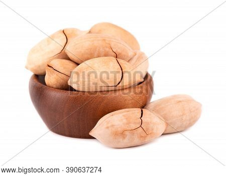 Pecan Nuts In Wooden Bowl, Isolated On White Background. Unshelled Pecan.