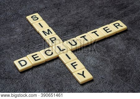simplify and declutter crossword in ivory letters against textured handmade bark paper, simplicity, minimalism and lifestyle concept