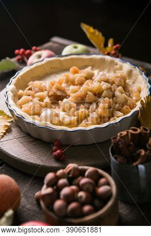 Homemade Apple Pie Surrounded By Fresh Fruits, Nuts, Apples. Homemade Delicious Apple Pie With Diffe