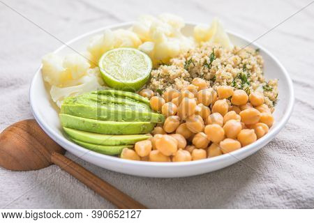 A Bowl Of Healthy Vegan And Vegetarian Lunch Or Dinner. Salad Of Fried Chickpeas, Quinoa, Avocado, C
