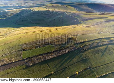 Terraced  Agricultural Fields Aerial Drone View In Transylvania, Romania At Autumn.