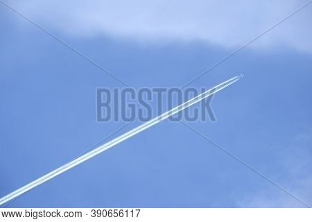 Big Passenger Supersonic Airplane With Four Jet Engines Flying High In Clear Cloudless Blue Sky, Lea