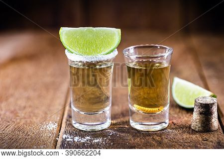 Typical Mexican Drinks, Glass With Tequila Served With Salt And Lemon, Next To A Mezcal (or Mescal)