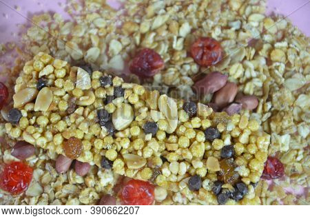 Granola Bars, Muesli Bars Or Energy Bars With Oats, Dates And Nuts On White Pink Background, Close U