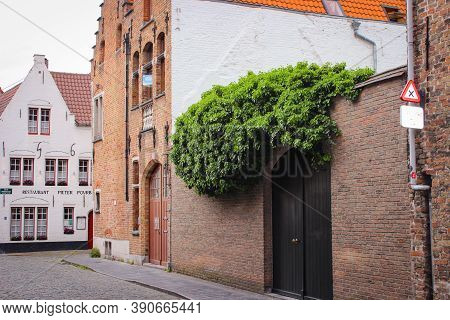 Bruges, Belgium - May 12, 2018: View To Exterior Very Old Restaurant Pieter Pourbus