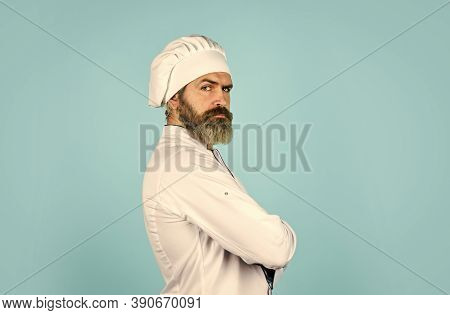 Chef Wear Apron And Hat. Healthy Food Cooking. Bearded Man Chef Uniform. Bearded Man Cooking In Kitc