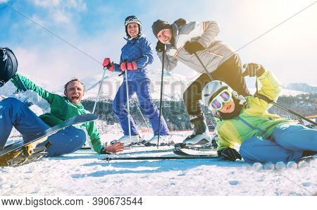 A Family With Little Son Dressed Ski Clothes Sincerely Smiling And Laughing Posing For Photo On The