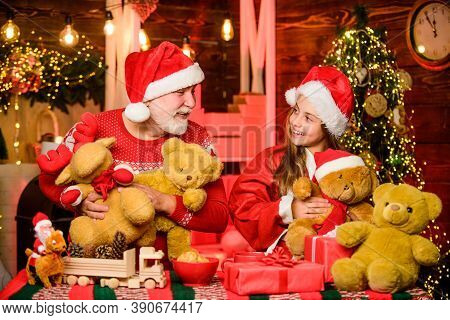 Happy Childhood. Lovely Present. Child Enjoy Christmas With Grandfather Santa Claus. Happiness And J