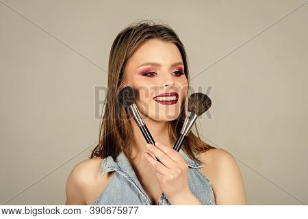 Fashion Makeup Visage. Sexy Woman With Professional Make Up Brush. Sensual Woman With Long Hair, Sty