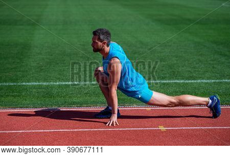 Keep Moving. Sportsman Relax. Athlete Train His Flexibility. Be Flexible. Man Doing Stretching Exerc