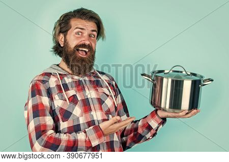 Presenting Product. Man Hold New Brand Pan. Shopping Kitchenware. Cooking Pot In Man Hands In Kitche