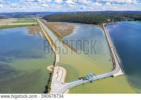 The Mouth Of A River Mirna Into The Adriatic Sea, In The Background A Bridge Over Mirna River, Anten