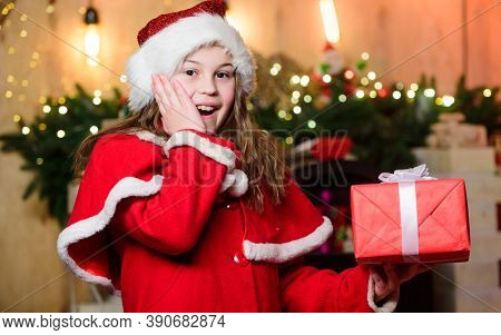 Santa Claus Little Girl. Surprised Little Girl In Red Hat. Wait For Santa Claus. Christmas Time. San