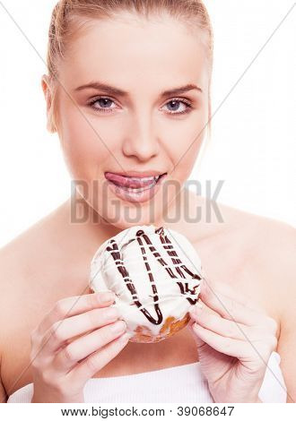 beautiful young blond woman eating a bun, isolated against white background