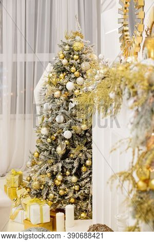 Christmas Tree With Presents .luxury New Year Decor. Beige, White, Golden, Silver Christmas Tree Dec