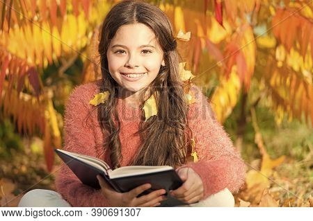 Child Enjoy Reading. Schoolgirl Study. Study Every Day. Girl Read Book Autumn Day. Little Child Enjo