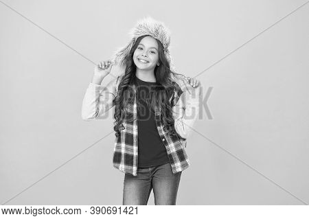 Kid Girl Wear Hat With Ear Flaps. Winter Events At School. Winter Entertainment. Child Carefree Scho
