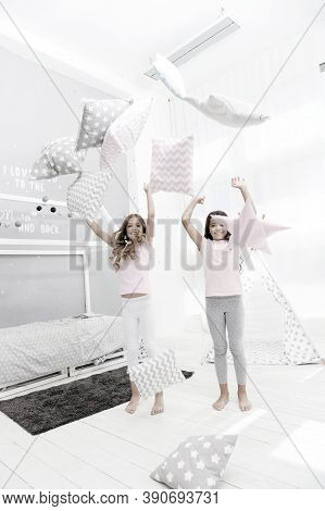 Evening Time For Fun. Sleepover Party Ideas. Sisters Play Pillows Bedroom Party. Pillow Fight Pajama