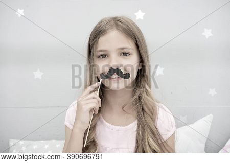 Having Fun With Fake Mustache. Happiness And Humor Concept. Kid Long Hair Happy Smile Face. Girl Car