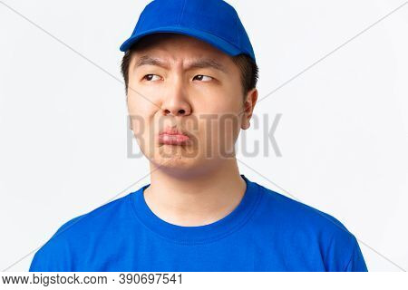 Online Shopping, Fast Shipping, Employees And Home Delivery Concept. Close-up Of Sulking Upset Asian