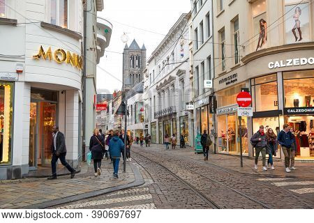16 December 2019, Ghent, Belgium. Old Buildings, Bright Shop Windows And A Lot Of People On The Stre