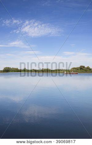 Fishing Boat On A Lake.