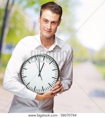 Happy Man Holding Clock In His Hand, Outdoor
