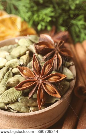 Dry Anise Star And Cardamon Seeds In Bowl, Closeup. Mulled Wine Ingredients