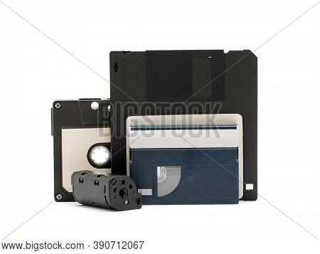Cassette tape, DV cassette, diskette and camera film roll isolated on white background. Vintage concept.