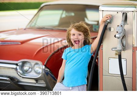 Kid Fueling Retro Car At Gas Station. Refuel Fill Up With Petrol Gasoline. Petrol Pump Filling Fuel