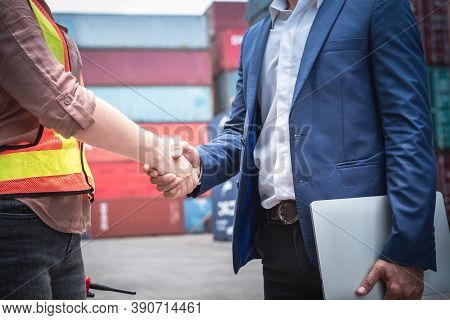 Businessman And Container Shipping Worker Handshake Together For Cooperation Shipment In Logistic Wa