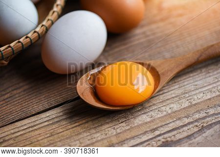 Fresh Egg Yolk On Wooden Spoon With Chicken Eggs And Duck Eggs Collect From Farm Products Natural In