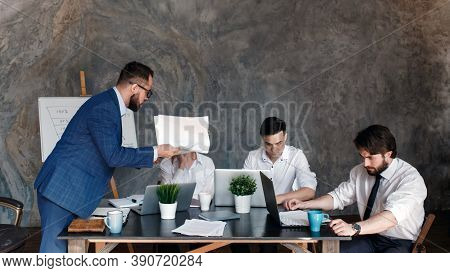 Angry Boss Reprimandingemployee For Bad Work Result Sitting At Conference Table, Male Ceo Scolding I