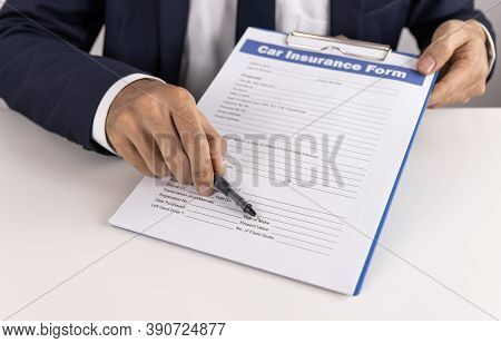 Insurance Agent Point Car Insurance Claim Form Or Insurance Document On Office Table For Customer Si