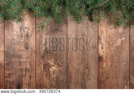 Christmas Background With Fir Tree. Christmas Tree Branches On Wooden Texture Ready For Your Design.