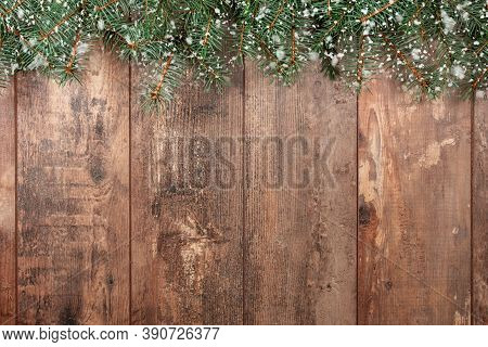 Christmas Background. Old Wood Background With Fir Branches And Snowflakes. Space For A Greeting Mes