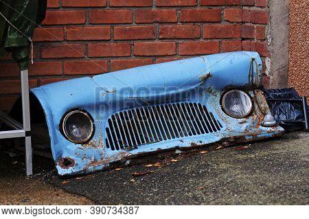 Part Of Broken Blue Car Front Fender