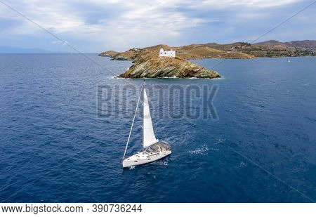 Sailing Boat With White Sails, Rippled Sea Background